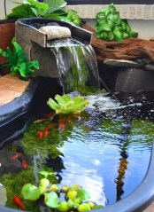 Adorable Fish Ponds Inspirations For Your Home 23