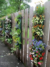 Beautiful Garden Fence Decorating Ideas To Follow 36