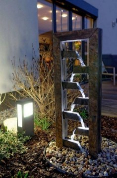 Innovative DIY Backyard Waterfall Ideas To Beautify Your Home Garden 06