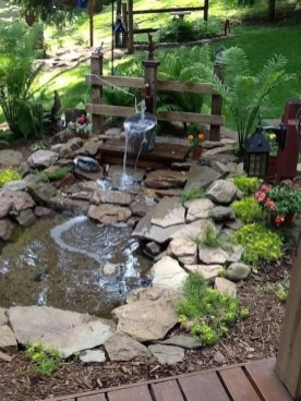 Innovative DIY Backyard Waterfall Ideas To Beautify Your Home Garden 15