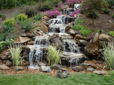 Innovative DIY Backyard Waterfall Ideas To Beautify Your Home Garden 21