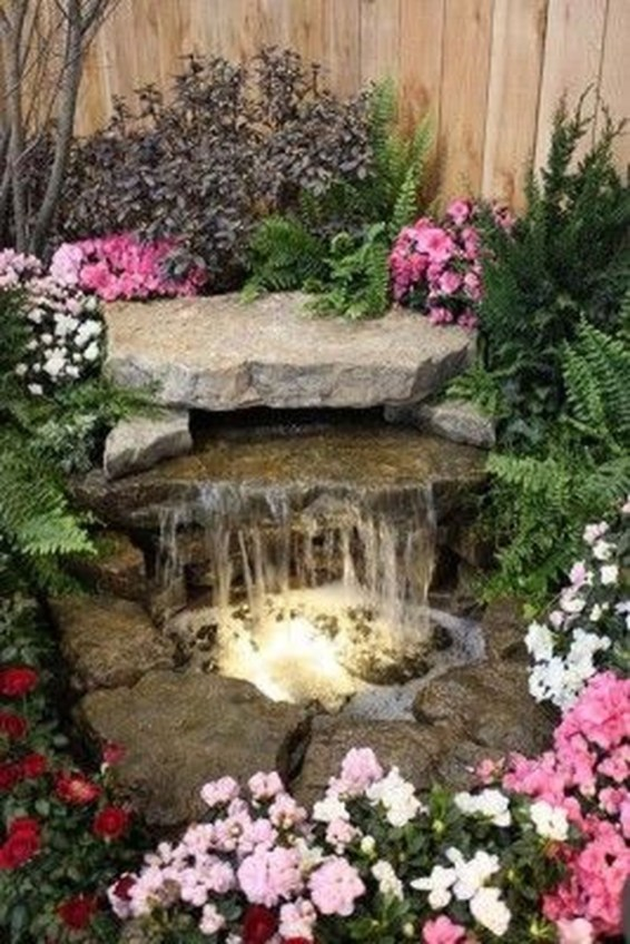 Innovative DIY Backyard Waterfall Ideas To Beautify Your Home Garden 38