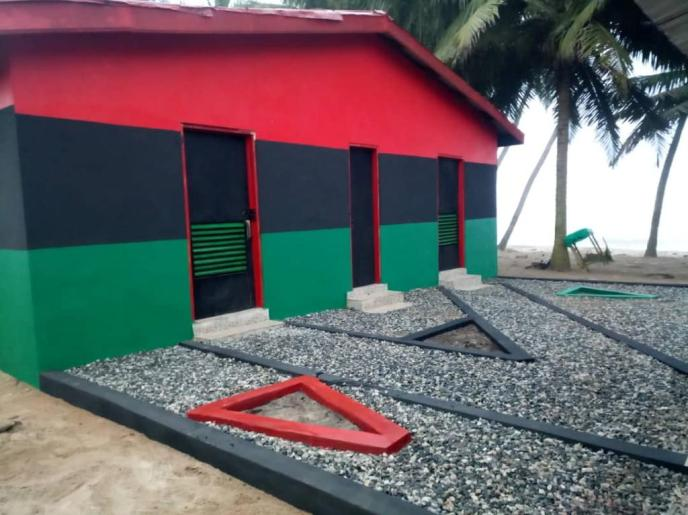 Front of completely painted public washroom in Saltpond, Ghana