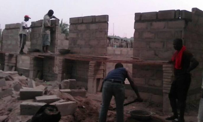Bricklayers working on the Love Africa Project public washroom to stop open defecation in Saltpond, Ghana