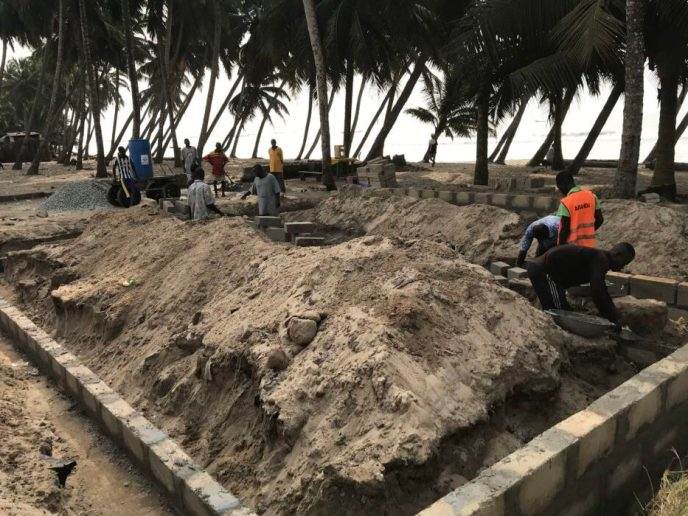 Building foundation walls for public washroom to help end open defecation in Saltpond, Ghana