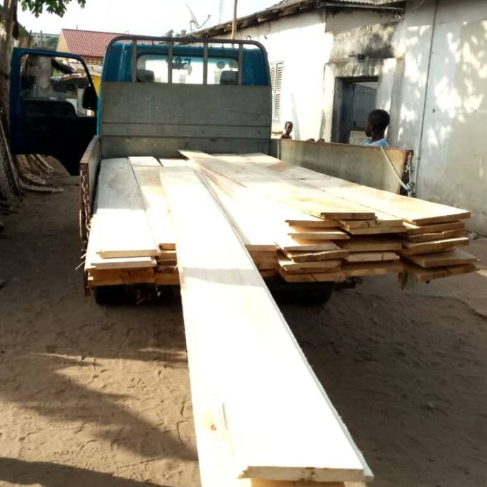 Lumber arrives to start building washroom stall doors for public washroom build in Saltpond, Ghana to help end open defecation.