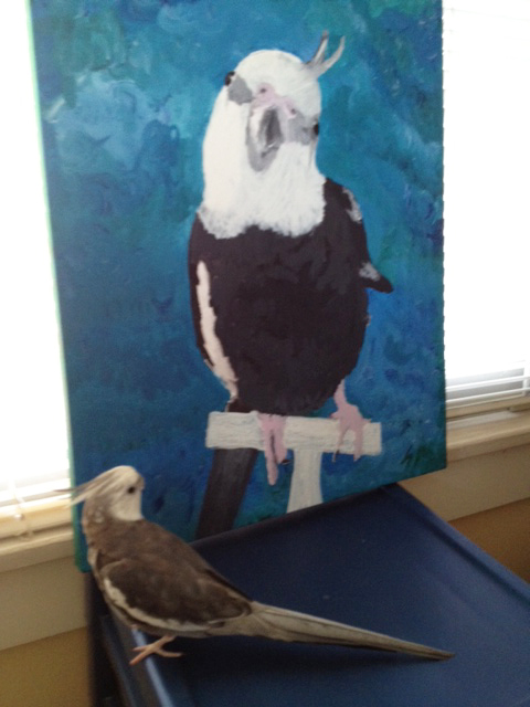 You can let your large featherless assistant paint your portrait (this also helps other painters know how to make their pets look prettier on canvas).
