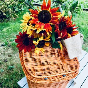wicker picnic basket with sunflowers