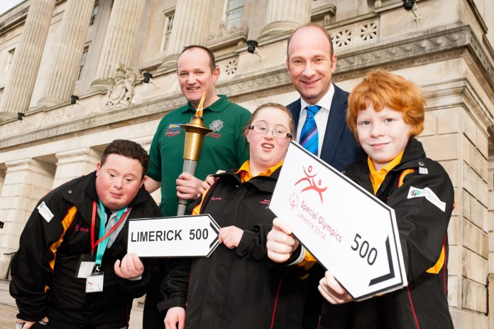 Athletes Julian McIntyre, Edel Kelly and Jonathan Special Olympics Ulster with Stevie Douglas Chairperson Law Enforcement Torch Run Committee PSNI and Stephen Watson BBC NI at Parliament Buildings Stormont. Picture Elaine Hill