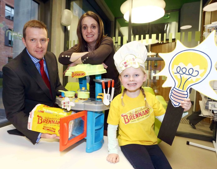 Colin Todd of Brennans Bread and Heather Carr of Arts and Business NI are joined by Grace McCracken, aged 5,
