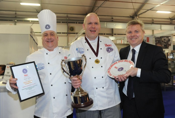 YES Chef!  Owens, Director of the Salon Culinaire at IFEX (left) and Permanent Secretary for the Department of Agriculture and Rural Development, Noel Lavery (right) are pictured presenting Shaun Hanna, chef and co-owner of the Linen Hill Kitchen