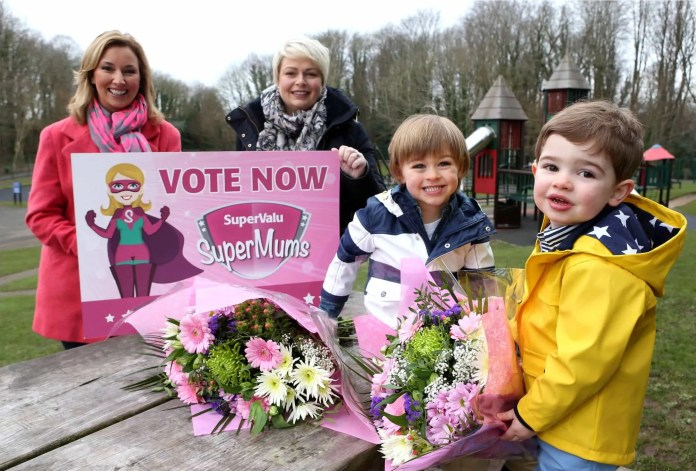TV personality Claire McCollum and SuperValuÕs Donna Morrison get a helping hand to launch the 2015 SuperValu SuperMums campaign from little Zachary Cameron (4) and Austin Hoey (3)