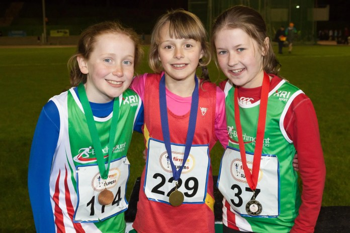 Maeve Haigney of Beechmount Harriers who came third; Anna Gardiner of East Down Athletic Club who came first and Aoife Dunlop from Beechmount Harriers who came second.