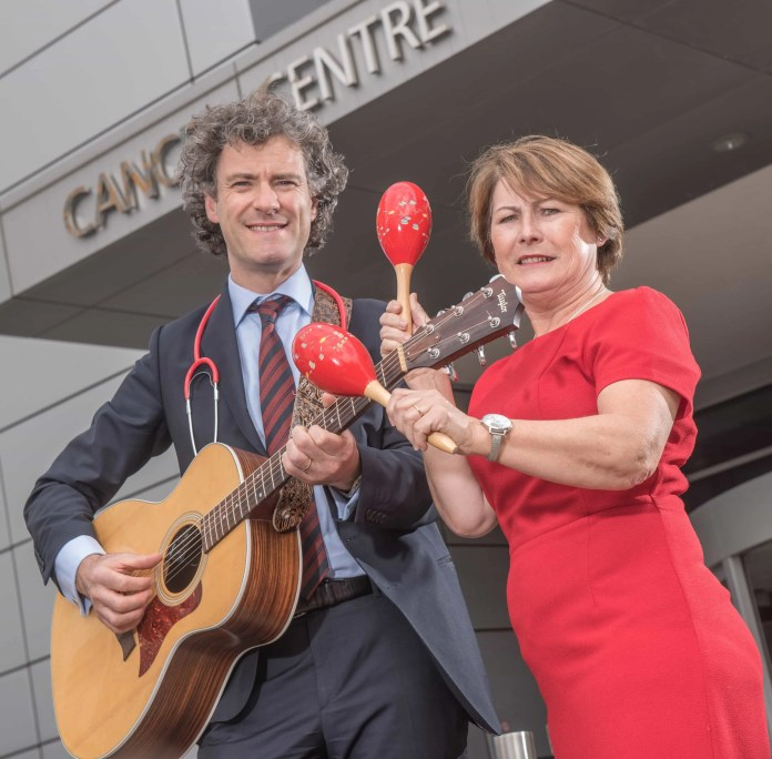 LEADING DOCTOR HITS THE RIGHT NOTES FOR CHARITY: Professor Joe O'Sullivan, clinical director of oncology at the Cancer Centre at Belfast City Hospital joins Colleen Shaw, chief executive of Friends of the Cancer Centre, to launch his debut album which features songs inspired by his patients and work as an oncologist.  Take a Deep Breath features ten tracks covering some of the memorable encounters Joe has had with his patients throughout his career.  In a fitting partnership all proceeds from the album are being donated to local charity, Friends of the Cancer Centre.  Take a Deep Breath is available to buy from today (Wednesday 17th June) from www.friendsofthecancercentre.com and iTunes.  Photo by Neil Harrison