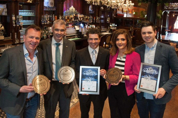 Henry McGlone, proprietor of Secrets Nightclub and Mary's Bar in Magherafelt join his management team to celebrate a hattrick of awards at the recent LCN Catering and Hospitality Awards.