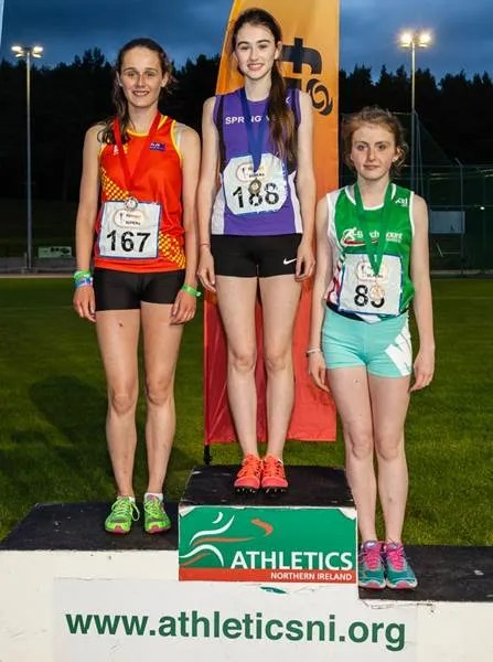 Pictured at Meet 5 of the firmus energy Super Six series are Aine McKinney (centre) from Springwell Running Club; Laura Gardiner (left) from East Down Athletic Club and Rioghnach Catney from Beechmount Harriers who came first, second and third respectively in the Under 17 Girls' 1500 metres.