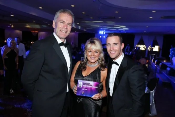 Small Business of the Year Award from  Des Moore, Head of First Trust at the Business Eye First Trust Small Business Awards at the La Mon Hotel, Belfast. Also in the photograph is X Factor singer Jay James.