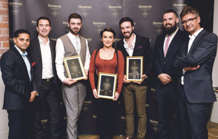 Pictured: Judges, Korgaonkar, head bartender at The Berkeley Hotel, London; Vincent Borjon-Prive, Hennessy;  with the newly named Hennessy Connoisseurs: Rosin McErlean, The Albany; Frankie Cosgrove, sixty6; Nathaniel McAuley, Muriel's Café Bar, Belfast and judges, Joel Neill, operations director, Hospitality Ulster and NI food critic, Joris Minne. The Hennessy Connoisseurs Challenge was created by drinks company, Dillon Bass - owners of the Hennessy brand in Northern Ireland - to celebrate the 250th anniversary of the cognac brand.  All three Hennessy Connoisseurs have won an impressive prize package, courtesy of Dillon Bass, which includes a VIP trip to Cognac to visit Maison Hennessy and Chateau Bagnolet, where they will receive one-on-one training, including a tasting with Hennessy's master blender. The Connoisseurs will also receive a bespoke training session with an Ambassadeur de la Maison Hennessy; tickets to a special Hennessy 250 dinner in Belfast and the opportunity to have their signature drinks showcased by the brand.  Frankie Cosgrove from sixty6, Belfast will also get the opportunity to attend the Hennessy Art of Mixology event in Cognac in September, having been singled out by the judges as an 'outstanding' talent and 'the next great creative mind in the Belfast cocktail scene.' Picture by Elaine Hill.