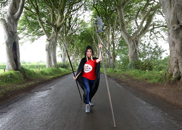 Sarah Travers gets into character along the Kings Road from Game of Thrones to help launch Northern Ireland Chest, Heart & Stroke's Causeway Coast Challenge Walk on 26th September 2015.  The Dark Hedges outside Ballymoney was used for filming on the popular TV show and the NICHS walks series takes in locations such as Ballintoy Harbour, Carrick-a-Rede's Larrybane Quarry and Tollymore Forest.  Sign up now at www.nichs.org.uk/challengewalks  Photo Credit – Ken Reay