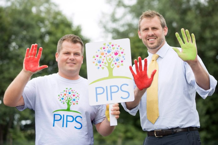 Brian Maguire, Chief Executive of PIPS, with Brian Beattie, Marketing Director of Tennent's NI.