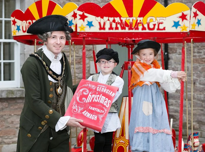 Lord Mayor of Armagh City, Banbridge and Craigavon Borough Council, Darryn Causby is joined by J.P. Donnelly (5) and Tara Brennan (6) in inviting everyone to come and celebrate the wonder of Armagh's annual Georgian Day on Saturday, November 28th. Inspired by the city's unique and historic Georgian cityscape, Armagh will be transformed into an awesome winter wonderland, with a packed schedule of family-fun events, activities and entertainment to enjoy from 10am until 9pm, most of which are free of charge, culminating in the must-see spectacular Georgian Day lightshow, which will illuminate the city's iconic Market House. For more information on Georgian Day, travel and transport options, in addition to all the events on offer in Armagh this Christmas, please visit www.armagh.co.uk/georgian