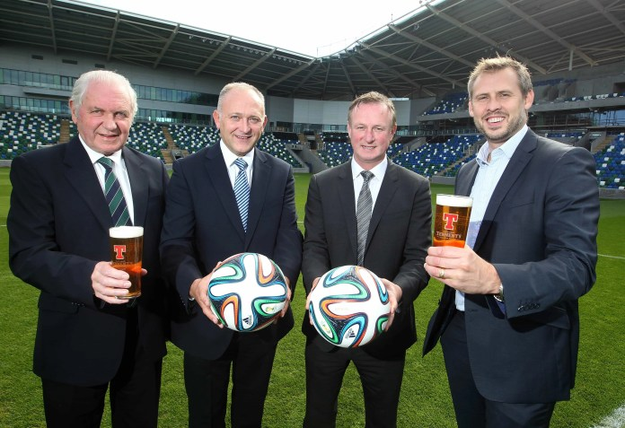 Jim Shaw, President of the IFA; Jeff Tosh, Sales Director, Tennent's NI; Michael O'Neill, Manager of the Northern Ireland Football Team; and Brian Beattie, Marketing Director, Tennent's NI.