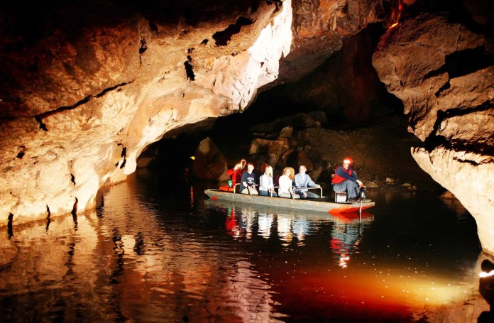 The Marble arch caves Spectacular walkways allow easy access while powerful lighting reveals the stunning beauty and grandeur of the caves. Electrically powered boats glide through huge caverns carrying visitors along a subterranean river.