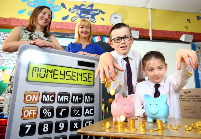 "Jill Smyth, Community Programme Manager at Ulster Bank, launches the Moneysense for primary schools initiative with the help of Miss Paul, Primary 5 teacher, Fairview Primary School, Ballyclare (left) and P5 pupils Andrew Cooper and Grace McAllister. PRESS RELEASE 3RD NOVEMBER, 2015 FINANCIAL EDUCATION PROGRAMME FOR PRIMARY SCHOOLS LAUNCHED Ulster Bank extends MoneySense initiative to cover 5-12 year olds An innovative financial education programme is being launched for primary school children in Northern Ireland. Ulster Bank is extending its popular MoneySense programme, which is currently being used by most local post-primary schools, to cover 5-12 year olds as well. Primary schools will be offered brand new, tailored content to help children begin to understand how to use money. It will cover areas such as the different ways to pay, the various types of bank accounts that are available, and why saving is important. It is free, impartial, supports the curriculum, and aims to make learning how to manage money real, relevant and engaging. Jill Smyth, Community Programme Manager at Ulster Bank, says: ""MoneySense provides an extensive range of resources that can be delivered by teachers in class, as well as activities that parents can carry out at home with their child. Teaching children about money is one of the most important things you can do to equip them for the future. MoneySense does just that."" Teachers can register for the programme now at www.mymoneysense.com The MoneySense financial education programme has helped millions of young people learn about money in nearly 60% of schools in the UK and Ireland for over 21 years. The MoneySense programme is educationally robust, and has been created with experts to support the curriculum. All resources are 100% impartial, and never promote products. ENDS"