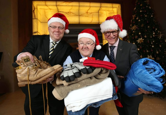 HELP THE HOMELESS WITH CLOTHES FOR CHRISTMAS…Peter McVerry from U105, Paul Doyle from Translink and James McGinn from Hastings Hotels are pictured at the launch of the Clothes for Christmas Appeal. The three leading local companies have joined forces with the Council for the Homeless NI and SOS Bus NI to encourage people to donate very specific clothing items that are most in need to help vulnerable people stay warm during the coldest time of the year. People can bring their donations to any six of the Hastings Hotels and ten of Translink's stations. For further information go to www.u105.com/clothesforchristmas/ and join the conversation online #clothesforchristmas