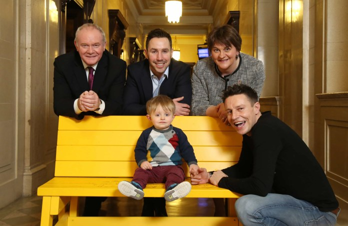 Pictured at the launch of the Paddy Wallace Fund for Autism 'Buddy Bench' initiative are (L-R) Deputy First Minister, Martin McGuinness MLA, Paddy Wallace and First Minister Arlene Foster MLA and along with young Robbie Clements and radio presenter Stephen Clements, who has just been announced as an ambassador for the Paddy Wallace Fund for Autism.