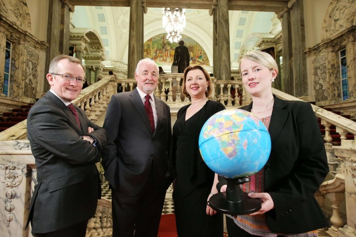 Press Release image  Press Eye - Northern Ireland - 12th April 2016 -  Tourism NI Chairman Terence Brannigan, centre left, and Niall Gibbons, Chief Executive of Tourism Ireland are pictured at the Meet the Buyer event with Ann O'Brien from Crystal Travel & Tours in Boston USA and Sarah Stanton from Cara Group Travel Boston. Over 100 international buyers from more than a dozen key tourism markets arrived in Belfast for the event organised by Tourism NI in association with Tourism Ireland. Ê Picture by Kelvin Boyes / Press Eye.