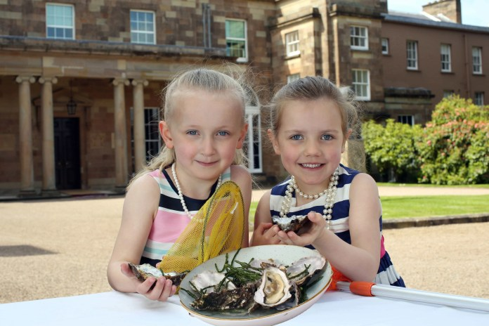 Nicole Campbell (age 5) and Katie McCabe (age 5) celebrate the launch of the world-famous Hillsborough International Oyster Festival
