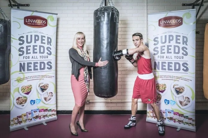Sarah Shimmons Head of Marketing Linwoods, watches as Michael Conlan the Commonwealth, European and recently crowned World Boxing Champion goes through his paces during one of his training sessions.
