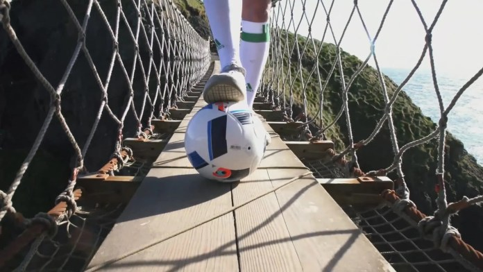 REPRO FREE 08/06/2016, Carrick-a-Rede Rope Bridge, Co Antrim – With kick-off to the European Championship nearly upon us, Tourism Ireland today launched its Euro 2016 campaign, to capitalise on the tourism potential of the tournament. PIC SHOWS: Freestyle footballer Jamie Knight in action on the Carrick-a-Rede Rope Bridge. Pic – Tourism Ireland (no repro fee) Further press info – Sinéad Grace, Tourism Ireland 087 685 9027