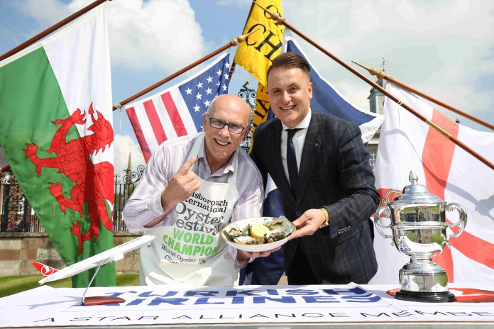 """The World is Colin's Oyster - but have you got what it takes? The Turkish Airlines World Oyster Eating Championship returns to the international stage at the Hillsborough International Oyster Festival on Saturday 3rd September 2016, when undefeated champion Colin Shirlow, pictured with Onur Gul, Ireland Marketing Executive, Turkish Airlines, will once again defend his title. The Dromore man faces added pressure this year as he takes on the challenge for the eleventh time and attempts to beat the new Guinness World Record which he set in 2015 by eating 235 oysters in 3 minutes.  Helping this international eating competition receive the global recognition it deserves is sponsor Turkish Airlines which aims to provide the necessary backing for attracting visitors and challengers from across the world to Northern Ireland's famous oyster festival.  Onur Gul, Turkish Airlines said: """"Turkish Airlines is very excited to be coming on-board as a principal sponsor for this year's Hillsborough International Oyster Festival and for the main event spectacle, the World Oyster Eating Championship. It is a very unique but lively event that attracts food enthusiasts worldwide which is a great boost for the local economy during the Festival."""" Now aged 60 years, oyster king Colin Shirlow, from Dromore, is hoping to meet his match in the 2016 competition. In past feats, he has encountered some of the world's best and fastest competitive eaters in the world including Matt Stonie, Sonya 'The Black Widow' Thomas, Miki Sudo, Bob Shoudt and Michelle Lesco, none of whom has been successful.  Sharing some of his pearls of wisdom, oyster eating champion Colin Shirlow said: """"Anyone wishing to compete against me in the Turkish Airlines World Oyster Eating Championship needs to understand that the game is quickness not quantity. It's my technique of speed-eating that most of my competitors find difficult to replicate and keep up with."""" For further information on the Hillsboro"""