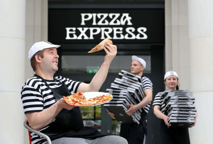 Pizza Express is celebrating its expansion across Belfast, with two outlets opening on 09 September in St. Anne's Square and Ballyhackamore. Pictured are three of the restaurant's Pizzaiolos at the new St. Anne's Square restaurant, Audrius Drumsta, Augustas Gylys and Aniko Keseru. The new openings takes the total number of Pizza Express restaurants in Belfast to five.