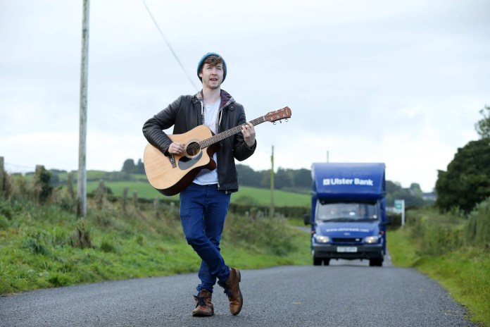 Belfast musician James Downey joined Ulster Bank's 'Bank on Wheels' and performed on its journey to serve customers in locations such as Carryduff to spread the word that Ulster Bank branches around the city will host artists such as musicians, dancers and magicians over the coming weeks in the build-up to the Ulster Bank Belfast International Arts Festival (11th – 29th October). Performances will take place on set days and times in branches from Connswater in the east of the city to Andersonstown in the west, starting on Monday (October 3rd).