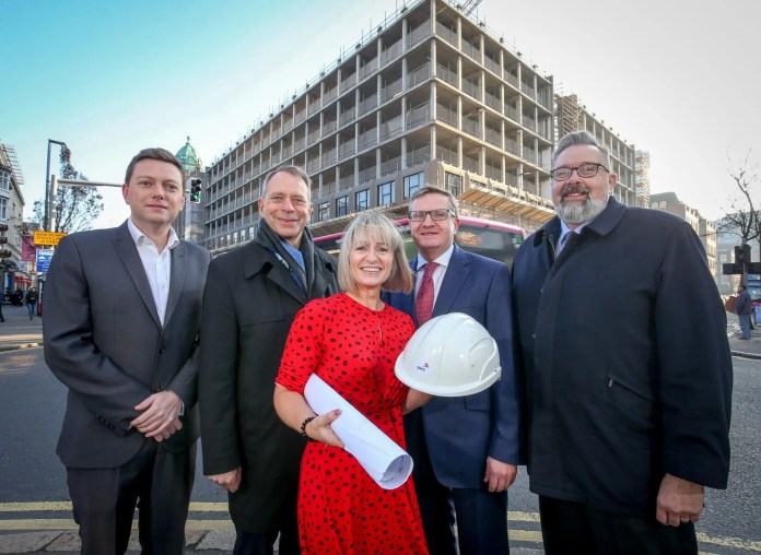 "PwC has struck Belfast's biggest private-sector office letting deal to become the anchor tenant in the city's Merchant Square development. Cllr Donal Lyons, Belfast City Council, Kevin Ellis, Chairman PWC UK, Kieragh Nelson, Director PWC, Gareth Graham, Oakland Holdings, & Paul Terrington, Regional Chairman PWC Currently based in Waterfront Plaza, PwC's existing 2,000 staff will relocate to Merchant Square in the summer of 2020. PwC says its plans for further investment and job creation mean it is running out of space in its current Belfast headquarters. The £70 million Merchant Square complex is being developed by Oakland Holdings, and straddles the junction of Wellington Place and Upper Queen Street, combining the former Oyster House and Royston House. When completed there will be over 200,000 sq feet of Grade A office accommodation on nine floors, with space for more than 3,000 people. PwC in Northern Ireland is PwC UK's fastest-growing UK region and its largest regional office outside London. Belfast is PwC's recognised global centre for technology, digital advisory services and research and is a major exporter of technology and regulatory advisory services. PwC in Northern Ireland recruited over 600 new staff on the past 12 months and has doubled local employment numbers to more than 2,000 in the last two years; largely due to the significant growth of Operate, the firm's innovative operational delivery division. Announcing the proposed move to local staff, Paul Terrington, Northern Ireland chair and head of UK regions said: ""This move underlines the PwC Executive Board's confidence in Northern Ireland as a location and the success of the firm here. We will continue to grow in local, national and international markets from Belfast, drawing on the technology skills emerging from our schools, universities and colleges. ""In the past year, PwC invested over £50m in the local economy and our decision to relocate to Merchant Square and concentrate our growth plans in Belfast reinforces our belief in the city's ability to inspire and support the creativity and aspirations of our people, and to help us attract and retain top talent here. ""We are investing in technology and collaborative space to ensure we can work well with clients from across the globe and with local business, education and social and community enterprise. We intend to make Merchant Square an accessible and vibrant part of life in the city."" With long-established credentials in the technology sector, PwC's Merchant Square base will be one of the city's most innovative digital spaces. Taking inspiration from the Frontier development in PwC's More London office, it will incorporate technology-enabled client collaboration and event space. Merchant Square will feature a state-of-the-art hub that will provide the infrastructure and environment where visionaries and technology innovators can collaborate, disrupt and create solutions that help clients solve complex problems . PwC Northern Ireland will remain the firm's global hub for blockchain, moving operations for this as well as PwC Research and the Google Innovation Lab to Merchant Square. For some long-tenured staff at PwC Northern Ireland, the move will be a homecoming. Oyster House was the original base for Price Waterhouse, before it merged with Coopers & Lybrand in 1998 and moved to Waterfront Plaza in November 2001. Speaking on behalf of Oakland Holdings, Gareth Graham said: ""Merchant Square will be one of the most striking office buildings ever undertaken in Belfast and will prove a catalyst for the wider regeneration of Belfast City Centre. While we undertook the Merchant Square development speculatively, we believed that the quality of the development would be a major advantage. That has proven to be the case and we are delighted to have secured PwC as the main tenant of the building. ""We designed every element of Merchant Square with the aim of providing the most innovative, attractive and competitive commercial space. We are excited at the potential of Merchant Square and the contribution it will have on the ongoing regeneration of Belfast and Northern Ireland."" Councillor Donal Lyons, chair of Belfast City Council's City Growth and Regeneration Committee, said: ""Our city centre regeneration and investment strategy outlines an exciting vision to develop a world-class city centre for the future and I'm delighted that PwC is part of that vision, creating its largest regional office outside of London here in Belfast, in the exciting Merchant Square development. ""A thriving city centre is vital to the local economy – not just for Belfast, but the entire region – and as part of the Belfast Region City Deal which has been secured, we are aiming to create up to 20,000 new and better jobs alongside delivering a 10 year programme of inclusive economic growth. ""The success and growth of PwC's Belfast base is proof that our city is delivering for global companies wishing to grow their international markets, and this move to new headquarters within the city demonstrates the firm's confidence in Belfast."""