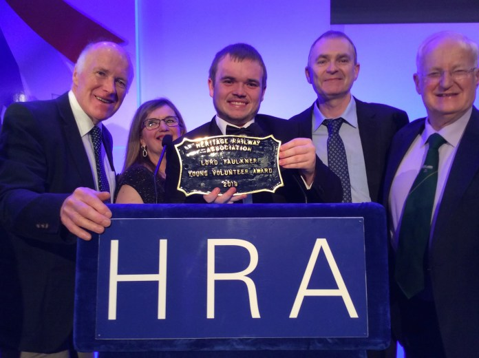 Matthew Wilson celebrates his award with his mum and dad, Ellen and David Wilson, in company of Robin Morton (left) of the RPSI and Johnny Glendinning, chairman of Heritage Railway Association Ireland.