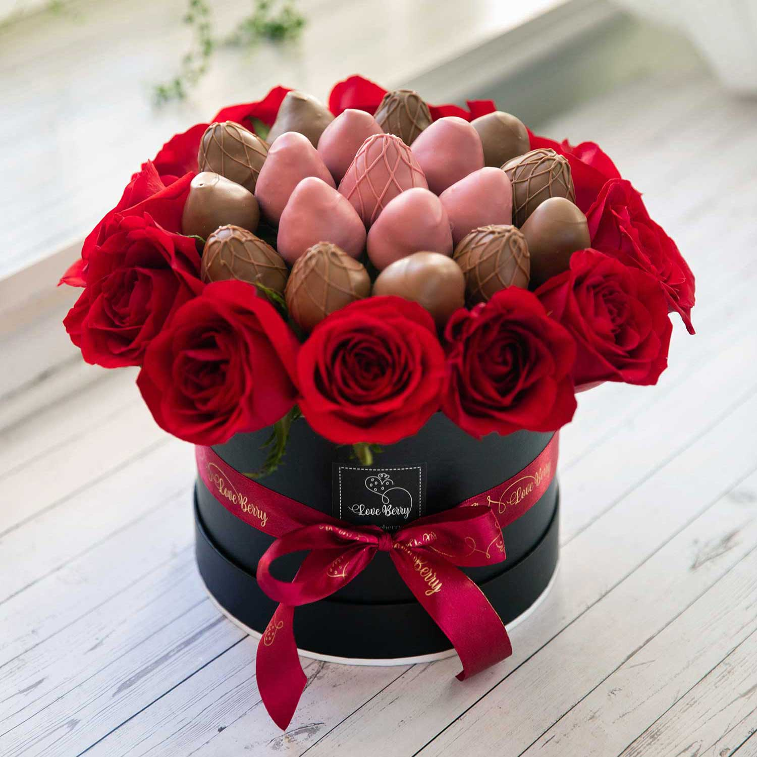 red roses with chocolate strawberries