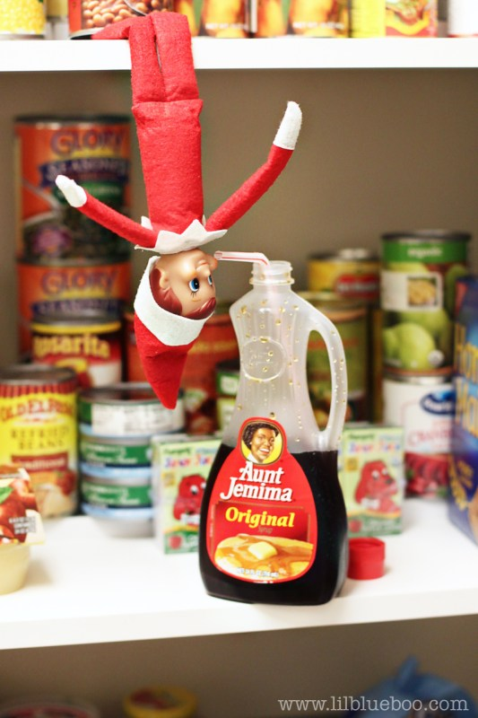 Elf on the Shelf Ideas - Elf Drinking Syrup in Pantry