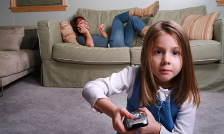 Babysitter on couch with charge watching TV