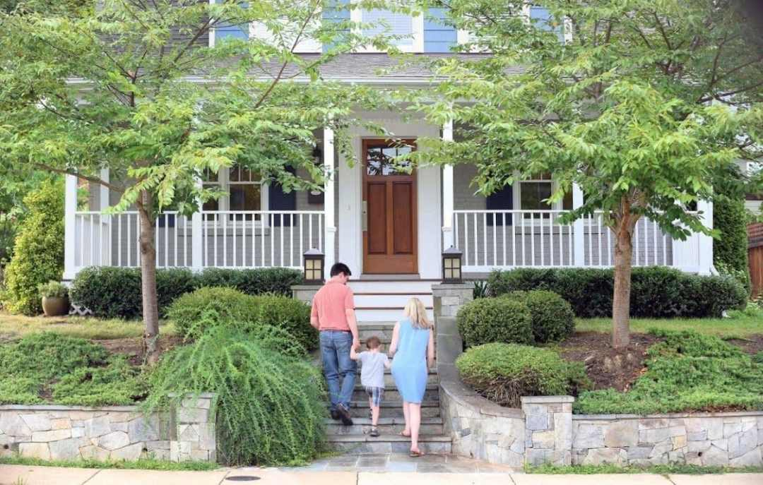 family-walking-into-home-2314528