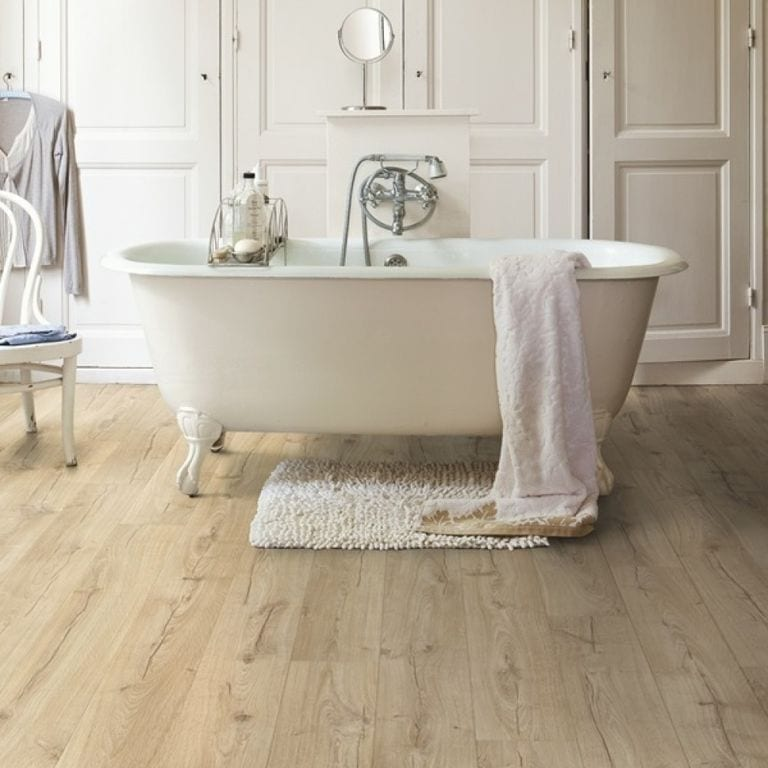 best flooring for a bathroom - roll top bath with laminate flooring