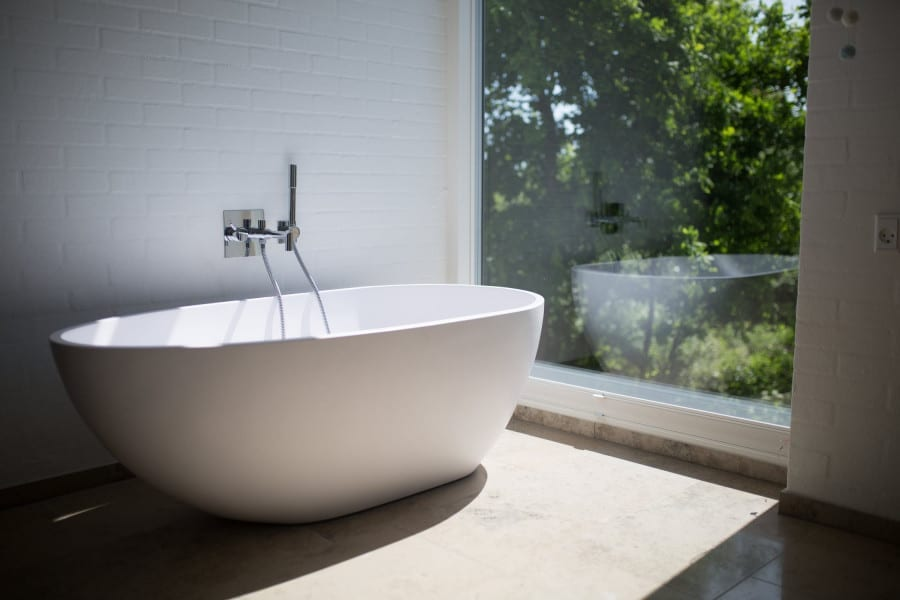 bath with window and view of trees