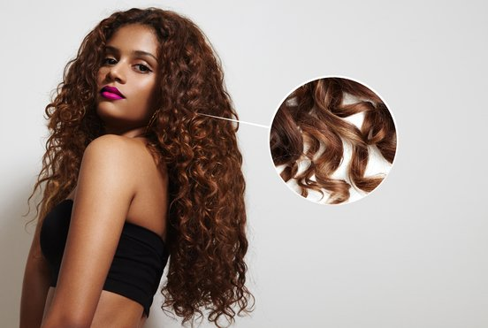 woman with long curly hair and a close up of the curl elasticity of her hair.
