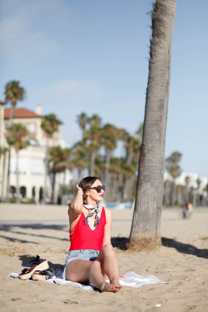 red bodysuit denim shorts bandana beach