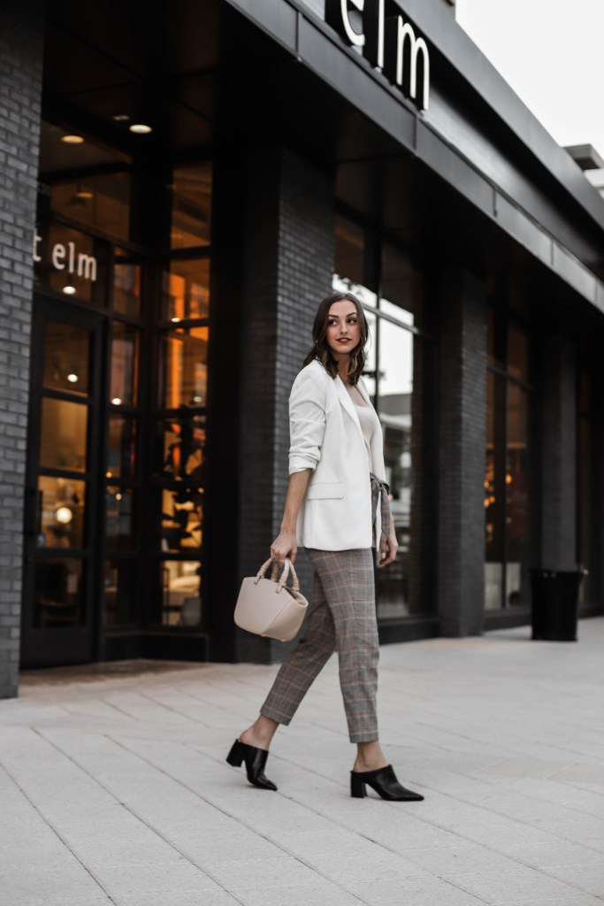 Love Emmarie workwear outfit with white blazer plaid pants and mules walking