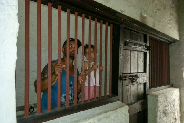 Rick and Em behind bars at the Old Busselton Jail