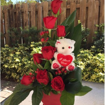 Cute Flower Arrangement With A Teddy Bear